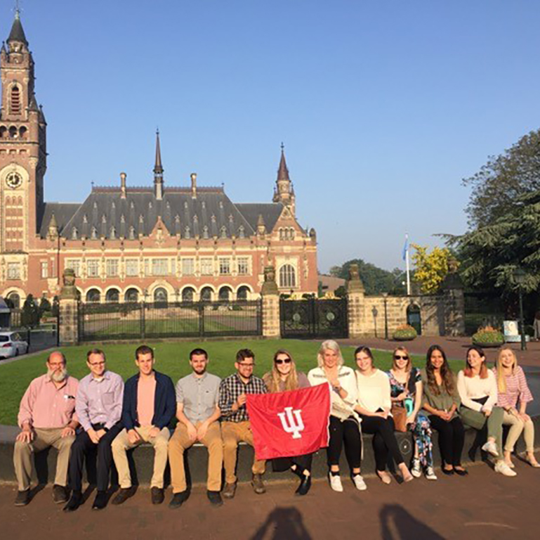 Indiana University group posing in front of Peace Palace