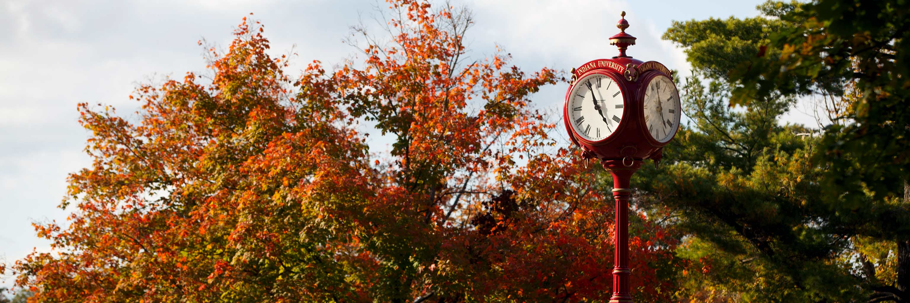 The red IU clock with fall leaves.