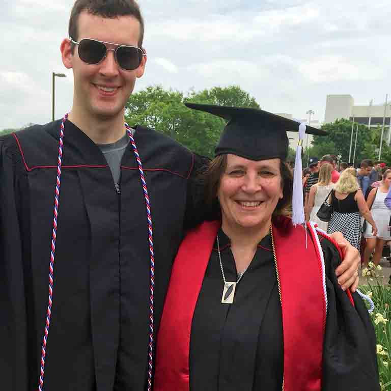 Barb McGinness and her son on her graduation day