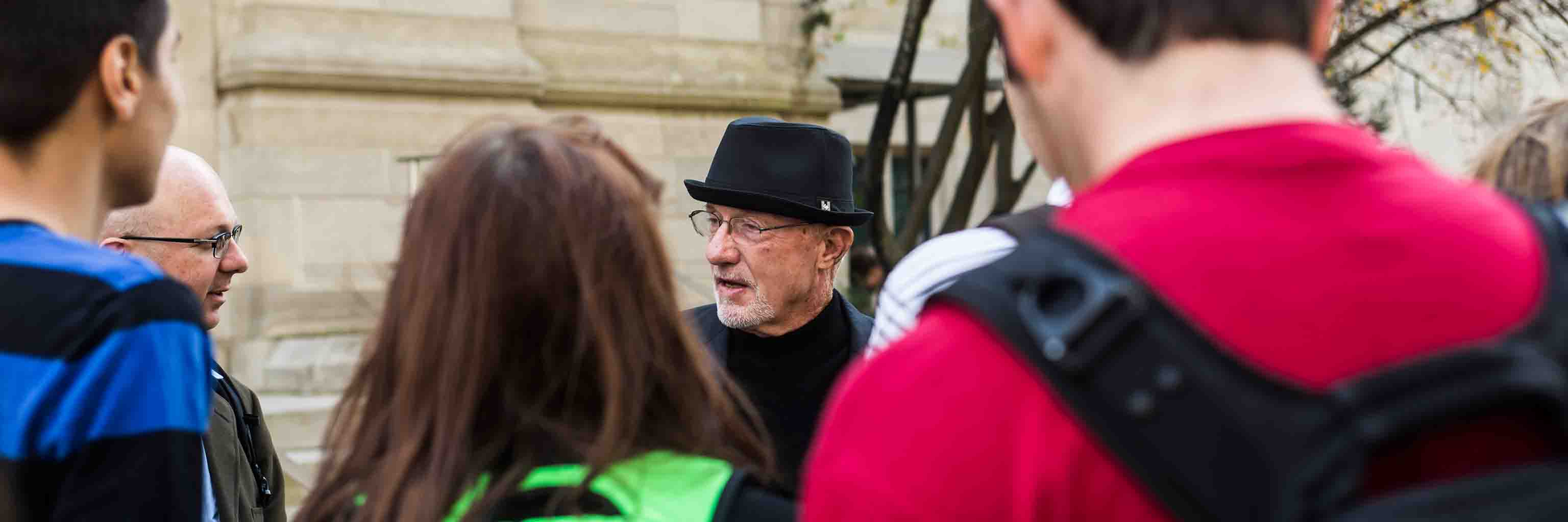 Actor Jonathan Banks speaks to a group in front of Franklin Hall.