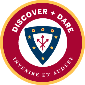 red circle emblem with discover + dare and invenire et audere lettering and college blue shield