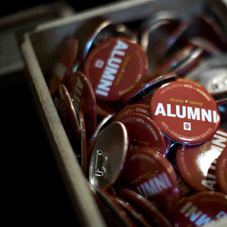 "A box of buttons that say ""sharp and savvy alumni."""
