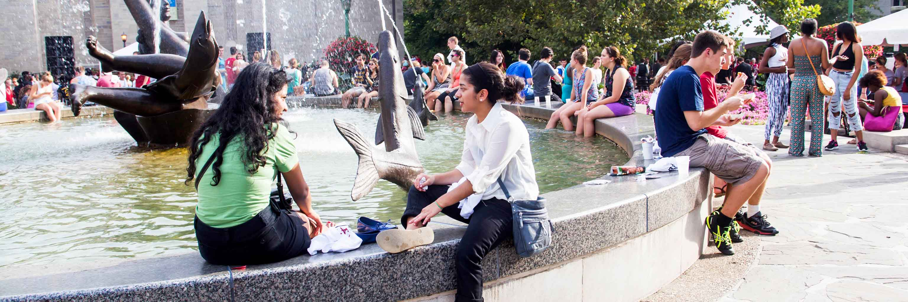 Students gather around Showalter Fountain.