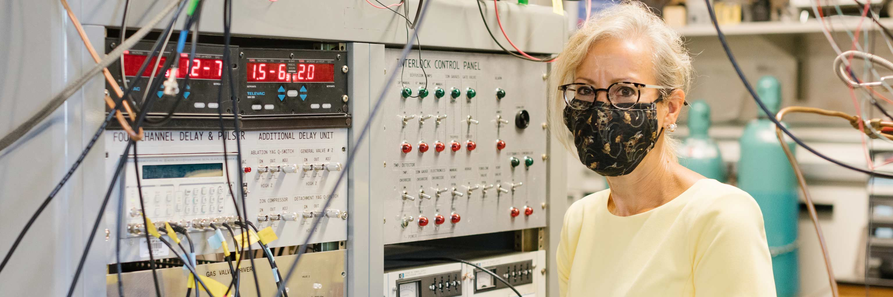 Caroline Jarrold in front of her chemistry equipment.