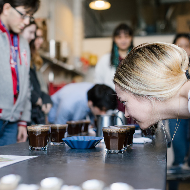 Students participating in a coffee tasting.