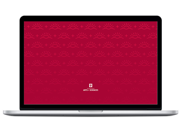 Image of laptop with crimson pattern wallpaper from the College of Arts and Sciences.