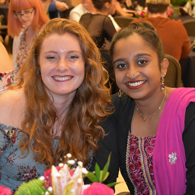 Two members of the Global Learning-Living Center pose for a photo at the End of Year Gala.