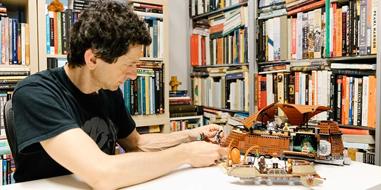 Marco Arnaudo in office with legos
