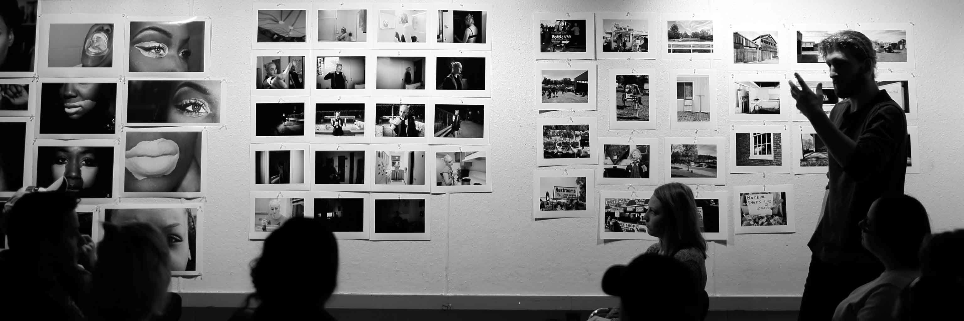 A wall of black and white photos