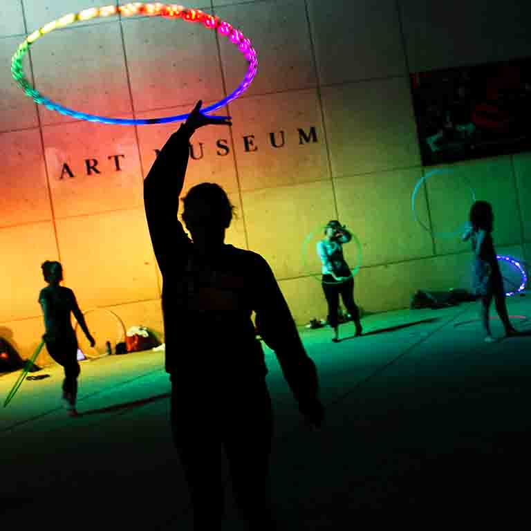 A group practices hooping in front of the IU Art Museum.