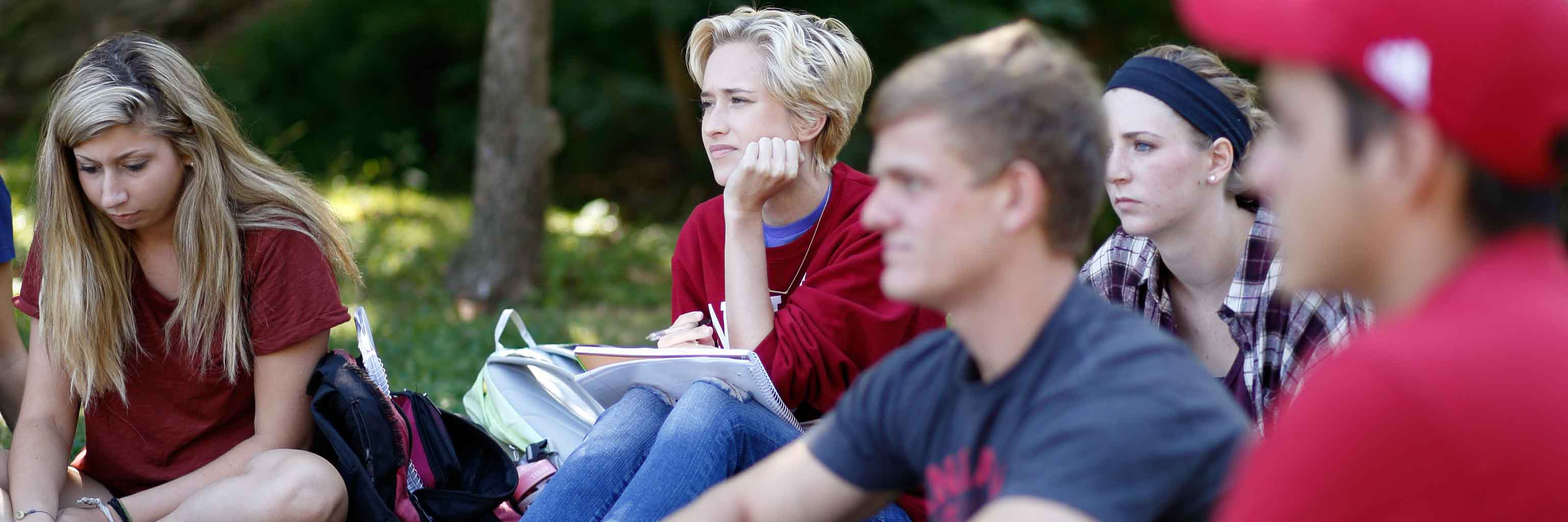 Students take part in a class session outdoors.
