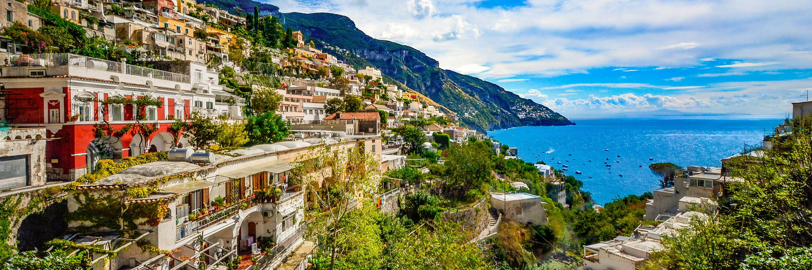 A colorful picture of the houses in Amalfi by the sea in Salerno, Italy.